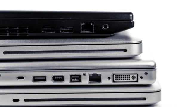 A bunch of laptops stacked together
