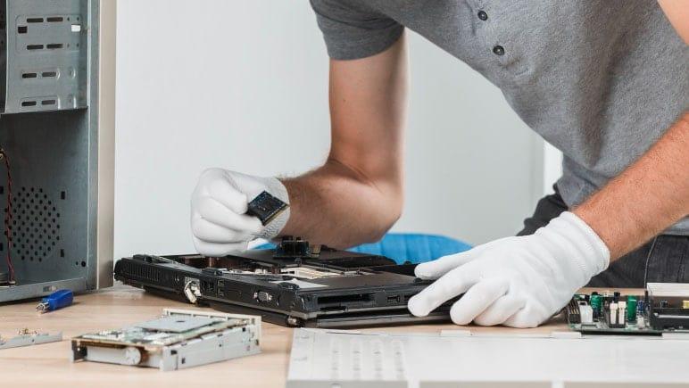 Technician repairing laptop