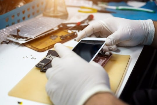 iPhone repair technician working